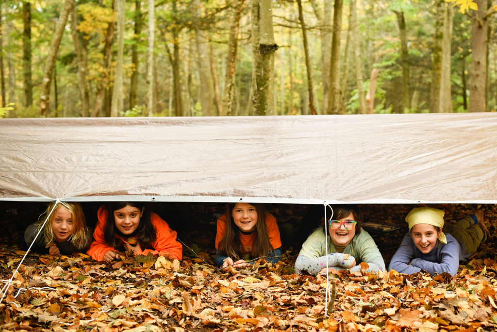 five students under a tarp